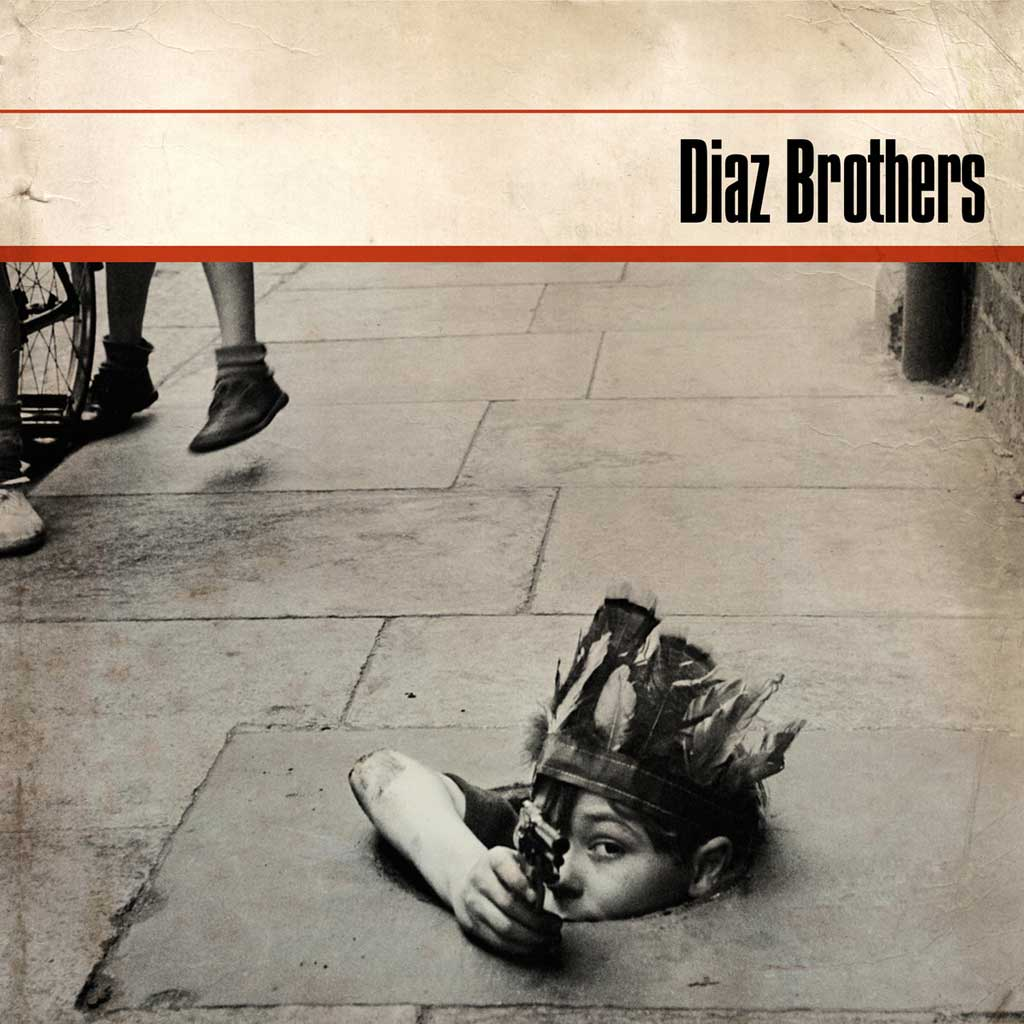 Picture of boy down drain for the Diaz Brothers album cover