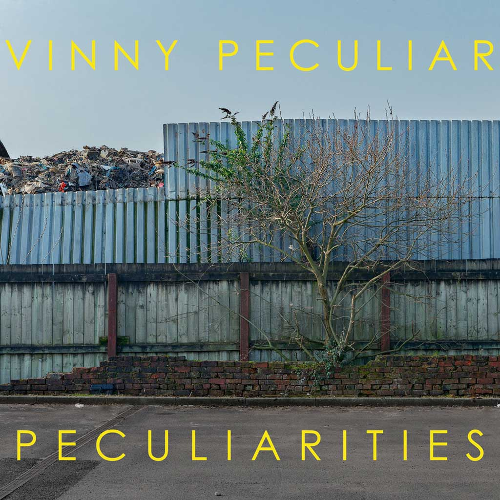Photo of a scrap yard for Vinny Peculiar Peculiarities album cover