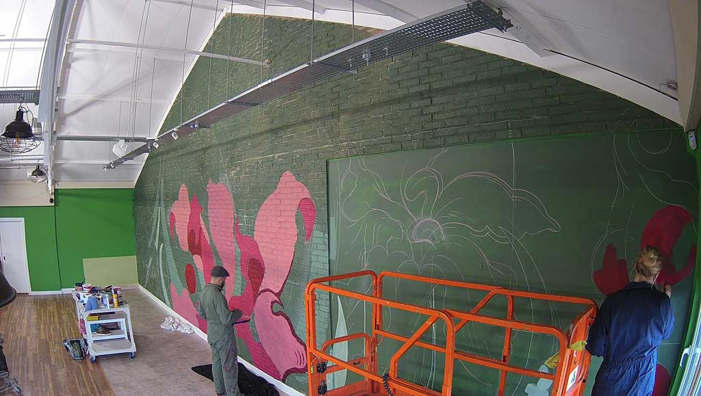 Photo of Mural by Phill Blake in progress
